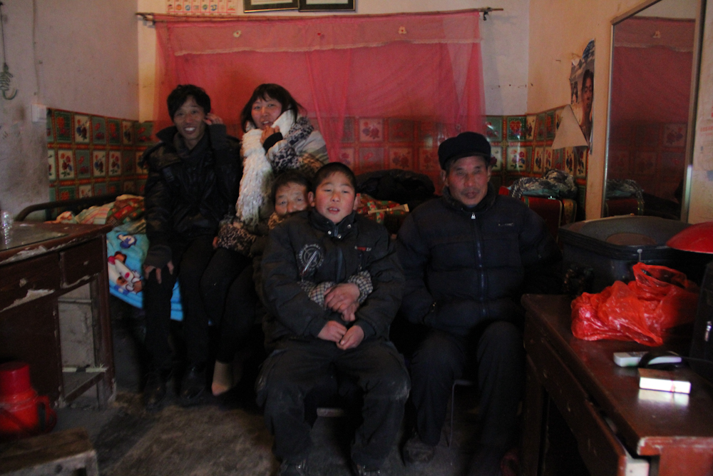 The entire family is gathered in the bedroom to watch the annual CCTV new year gala program, February 2013.