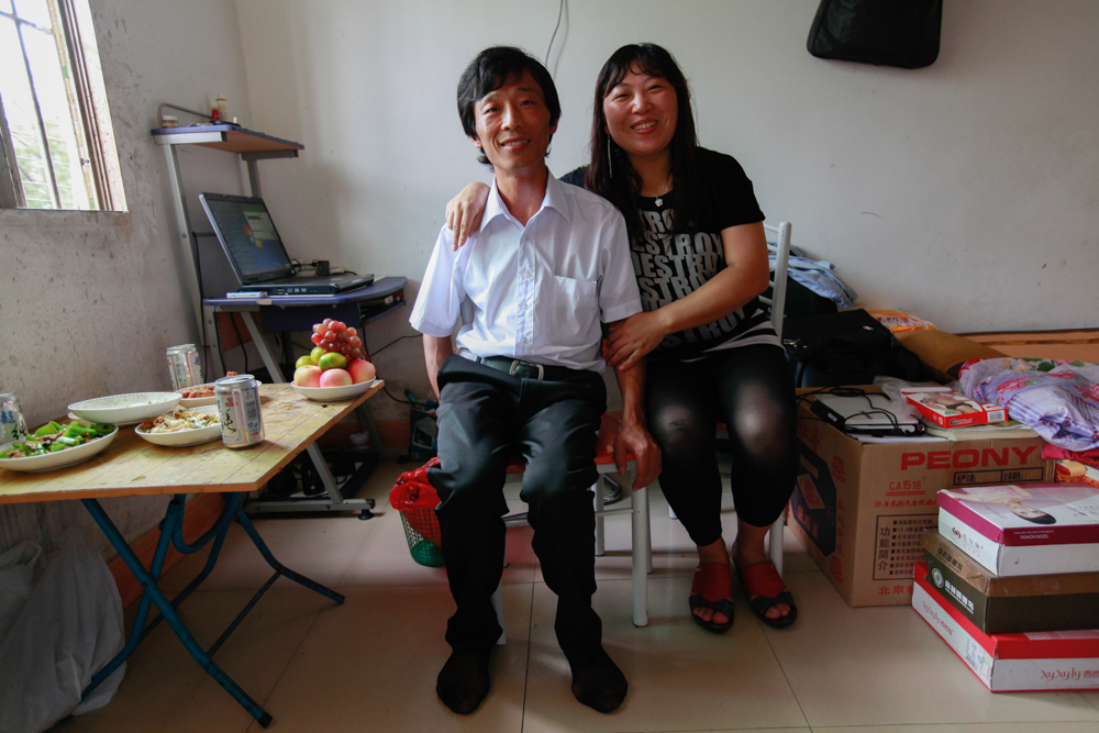 Yuan Zhitong and Zhang Junmei back in their Shenzhen factory dorm room, August 2013.