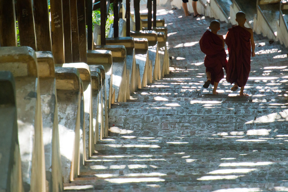 Monks climbing down the Mandalay hill at the Sutaungpyei Pagoda on one of the covered stairways, November 2012.