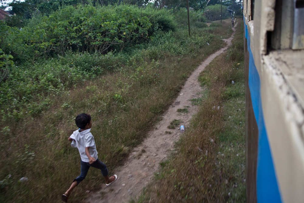 Child running after the train leaving Mandalay, November 2012.