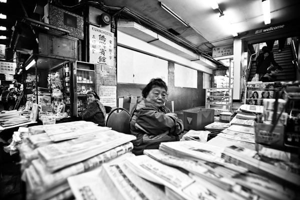 Newspaper lady in Yau Ma Tei, February 2012.