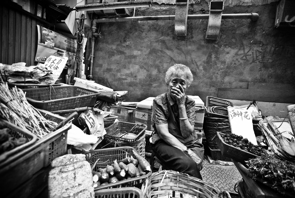 Old woman selling vegetables in Central, September 2012.