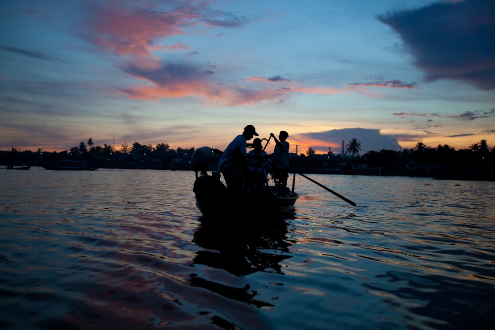 Dawn patrol: vendors heading to the market get an early start on the Mekong River in Vietnam, April 2012.