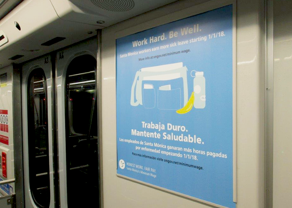 Bilingual ads on the Los Angeles Metro Expo Line Rail