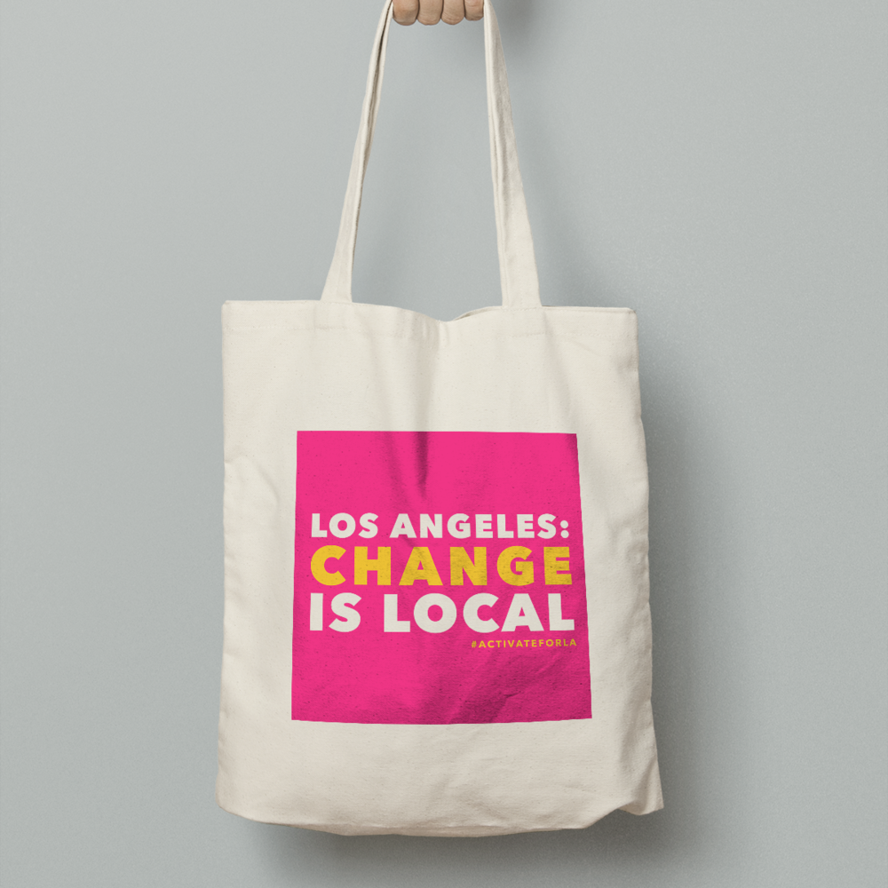 Our signature promotional tote bag, featuring our signature tagline: change is local.