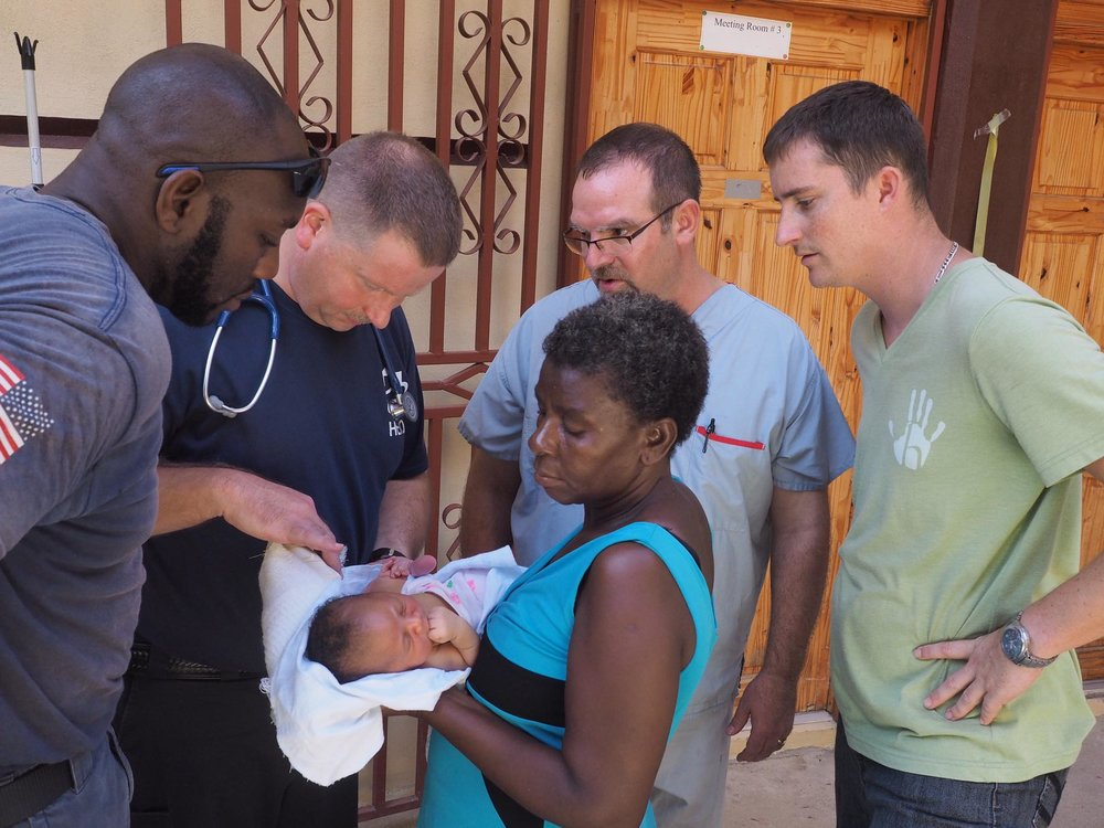 At the mission compound getting a report from the clinic staff.