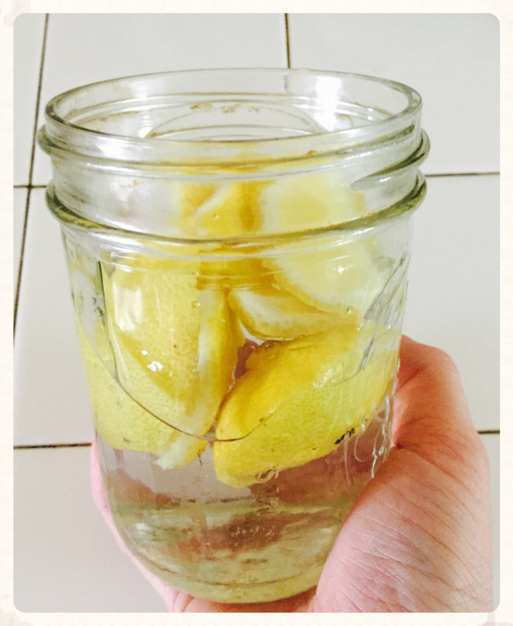 Infusing vinegar with lemon rinds.