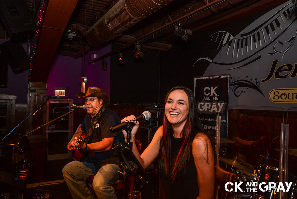 Neal Rudnik and Chrissy Karl of CK and The Gray performs at Jenny's Southside Tap in Mokena