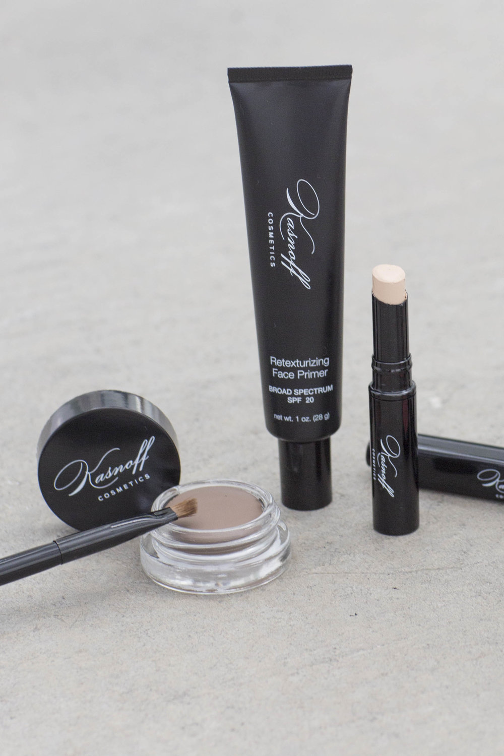 From left to right: brow balm, retexturizing face primer, mineral photo touch concealer.