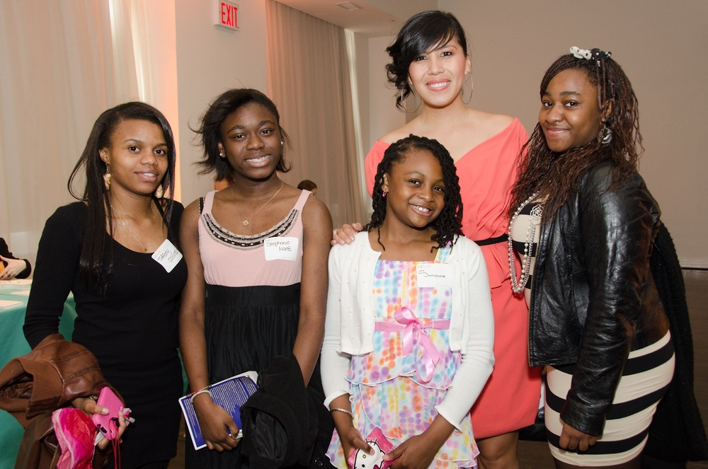 Ruby with Girls LitClub Members from Harlem, New York City. All the young women in Ruby's Girls LitClub was successfully admitted into four year universities.