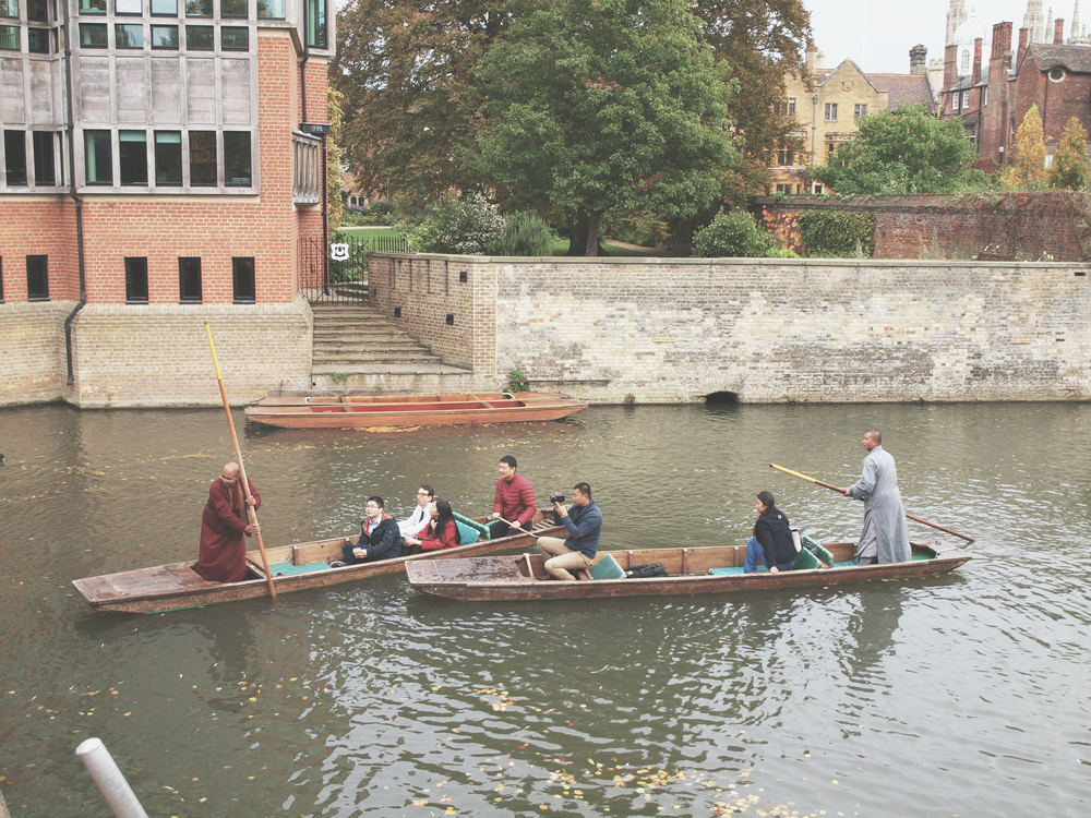 Monks in a punt boat
