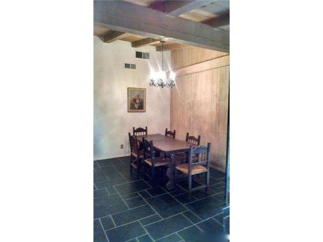 Dining-room-and-entry-have-slate-flooring-and-open.jpg