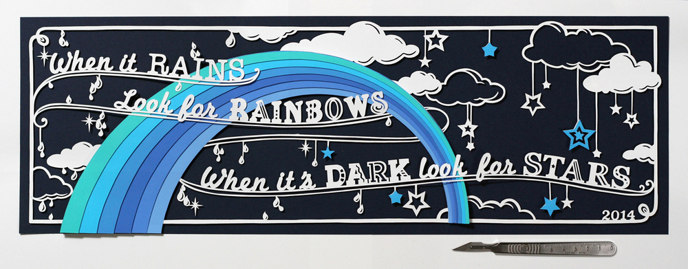 papercut illustration with rainbow and stars in shades of blue