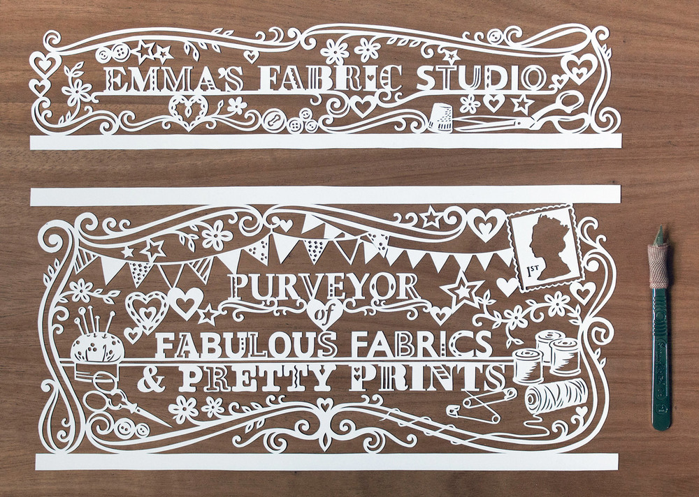 papercut illustration for Emmas Fabric Studio with sewing and bunting