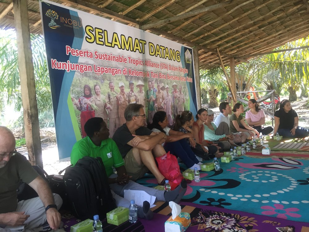 STA members are welcomed by indigenous palm oil farmers and listen to their stories of success.
