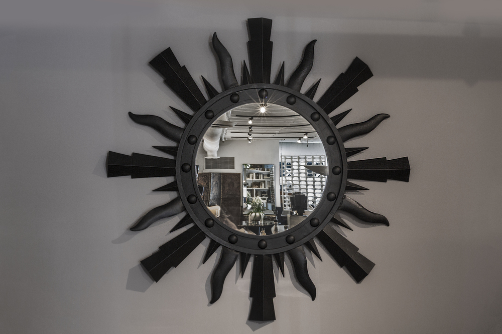 "Starburst mirror 48"" dia. $6,400"