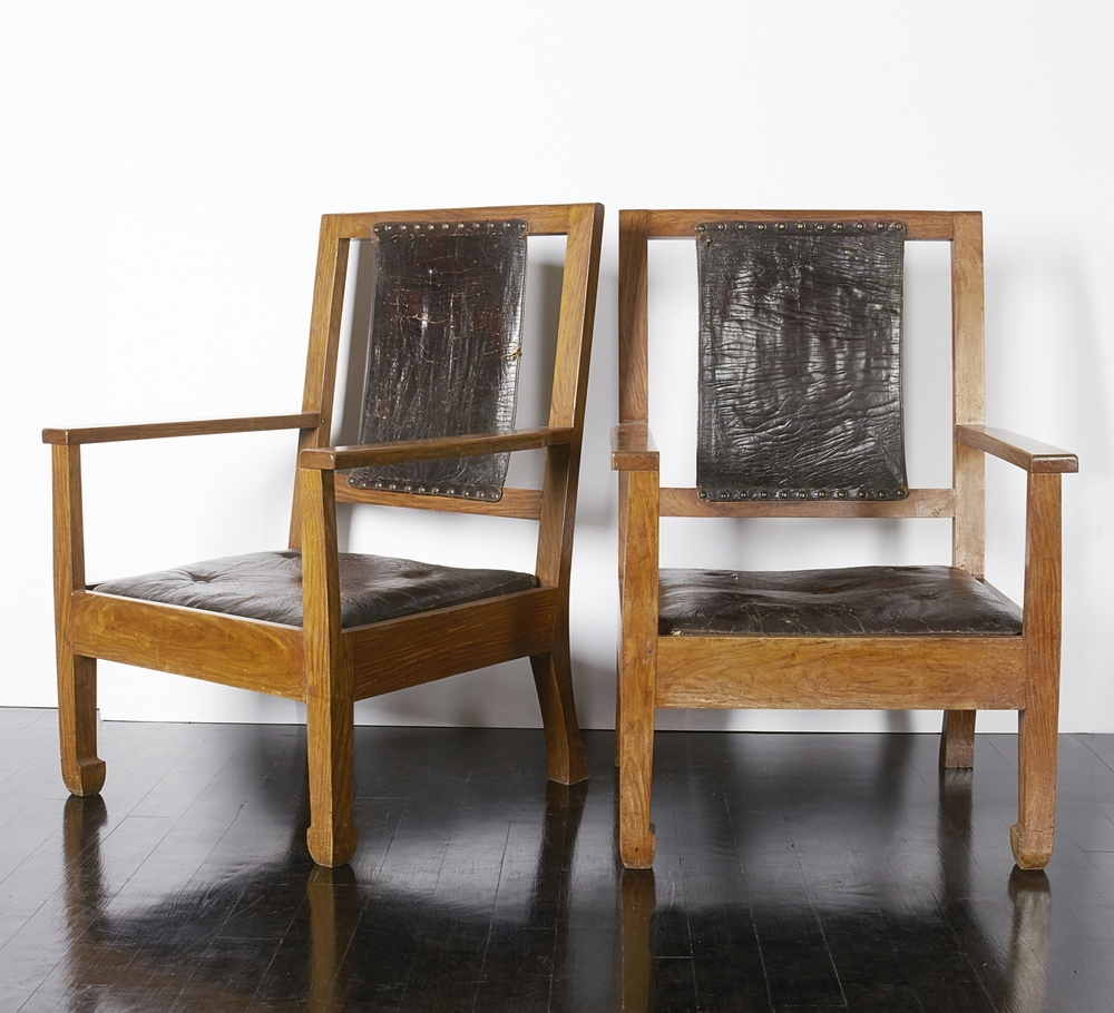 "Pair of oak and leather chairs 36"" h.  x  25"" w.  x  22"" d.  x 14"" seat  $7,800"