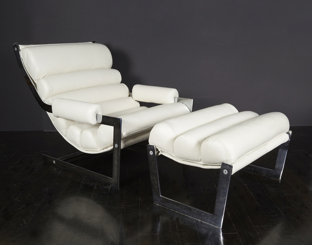 "White leather chair and ottoman 34"" d.  x  30"" h.  x  29"" w.  $16,000"
