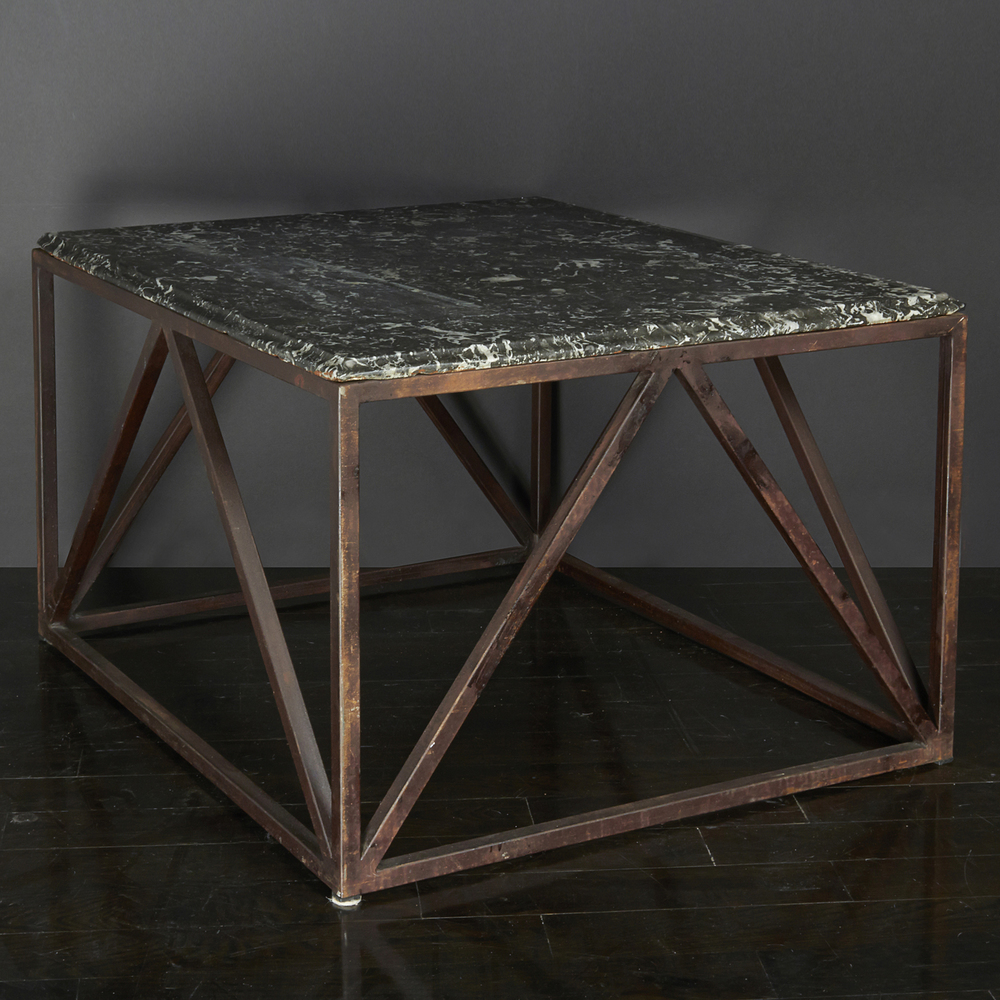 "Belgian stone and iron table 30"" d.  x  27"" w.  x  19"" h.  $6,400"