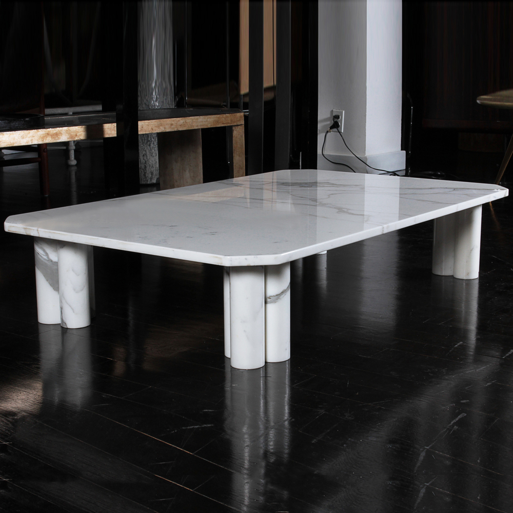 "Italian marble coffee table 52"" l.  x  32"" d.  x  10.5"" h. $8,900"