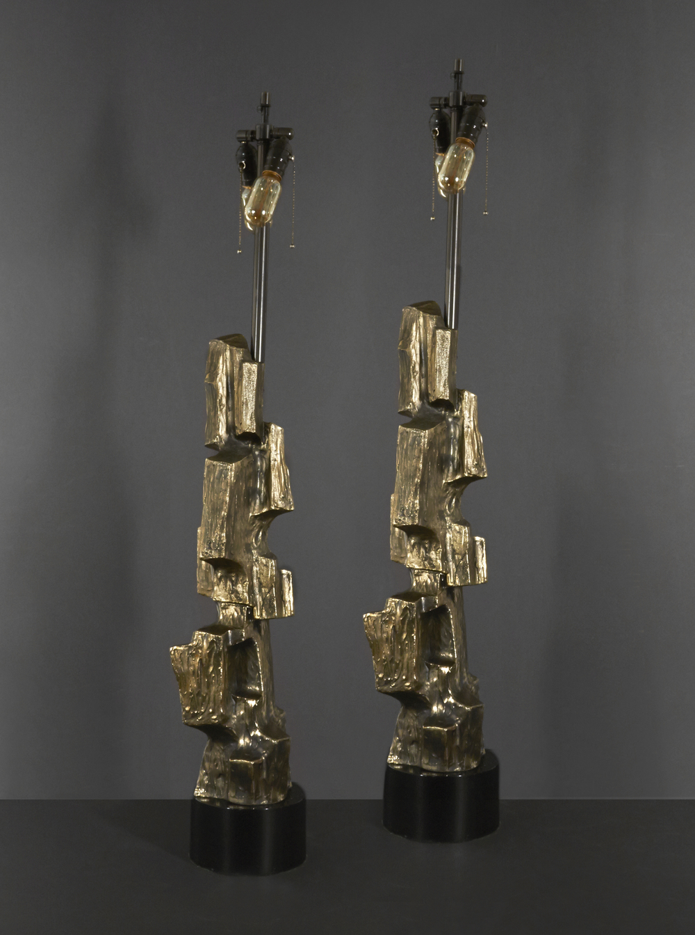 "Pair of Brutalist lamps 47"" h.  x  6"" d.  $14,000"