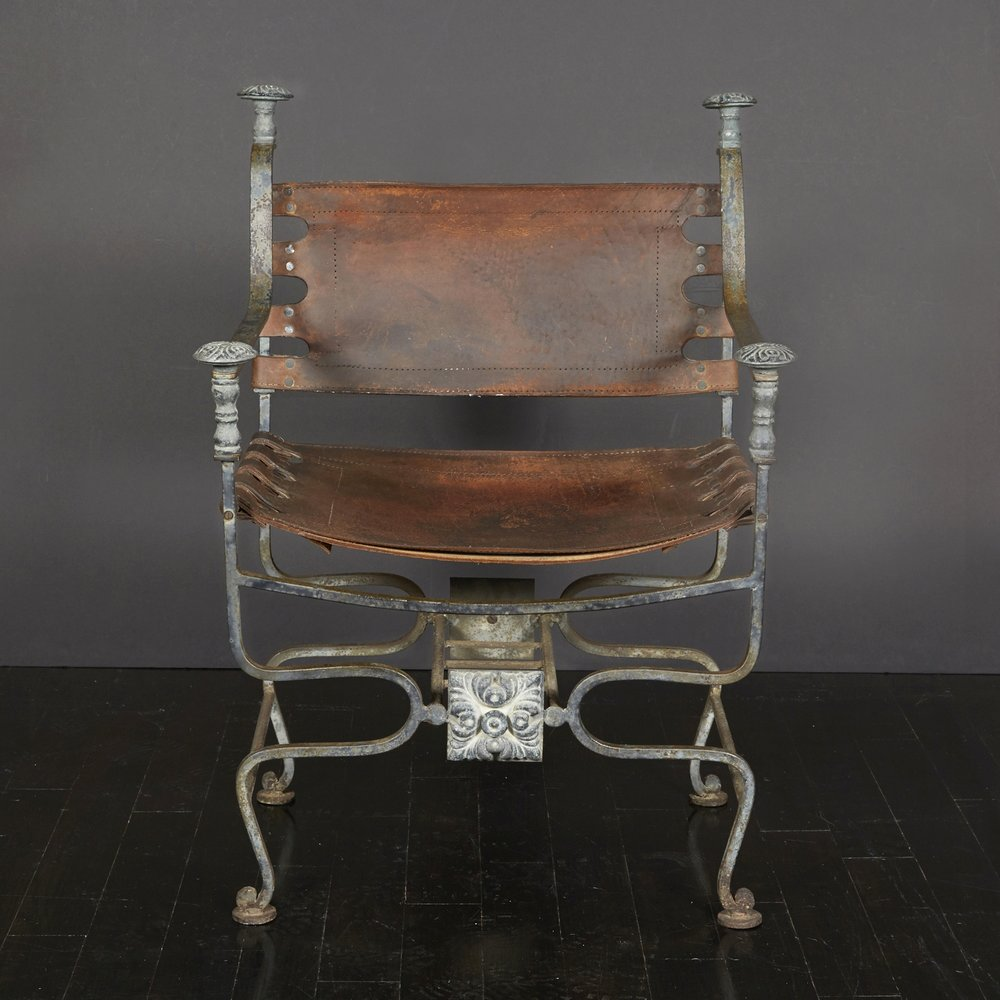 "Spanish leather chair 34"" h.  x  24"" w.  x  18"" d.  $3,800"