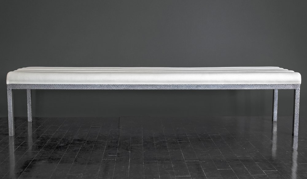 "White Leather Bench  84"" w.  x  21"" d.  x  18.5"" h.   $16,000"
