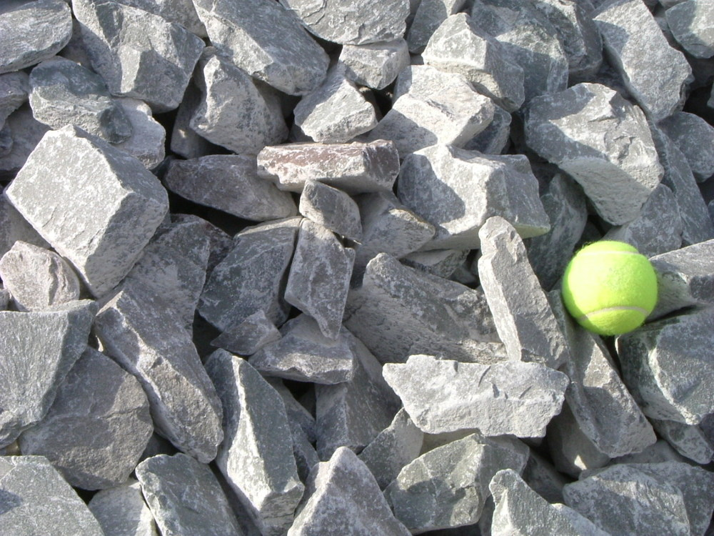 Use this tennis ball in the picture to gain a perspective on the size of the stone.