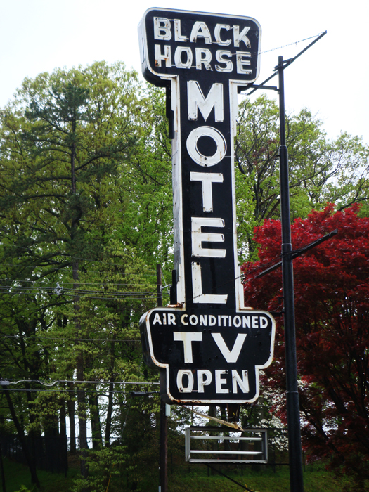 sign from the black horse motel