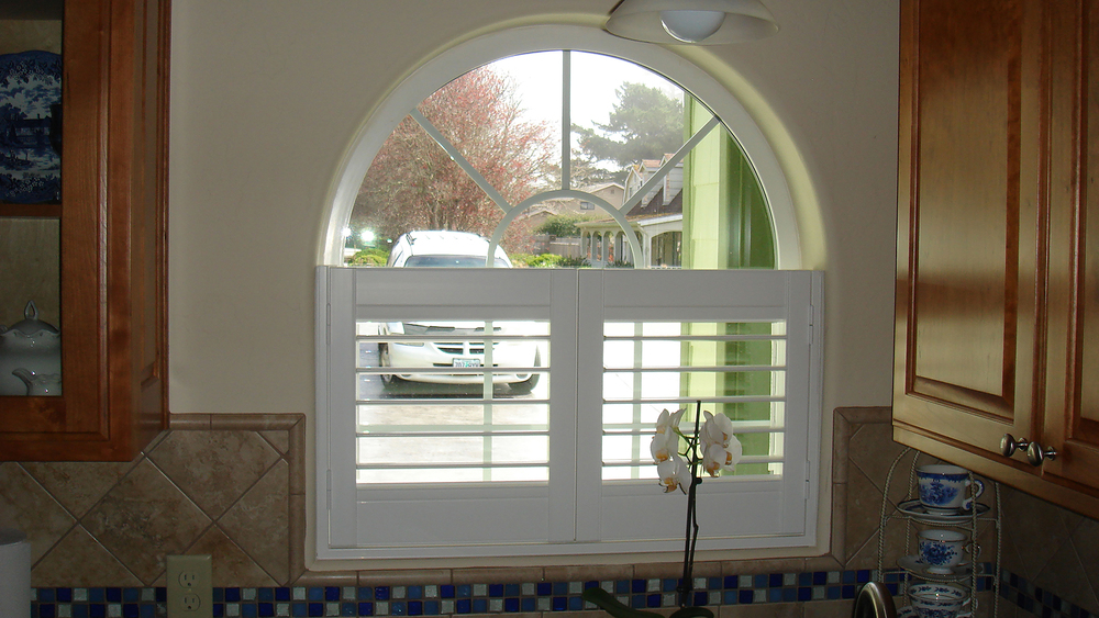 Cafe Style Vinyl Shutter in arched window.jpg