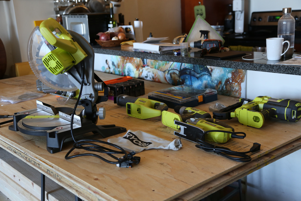Should have bought stock in RYOBI, yo / We would learn to use all of these, which still amazes me / Plywood on barstools makes a great temporary table