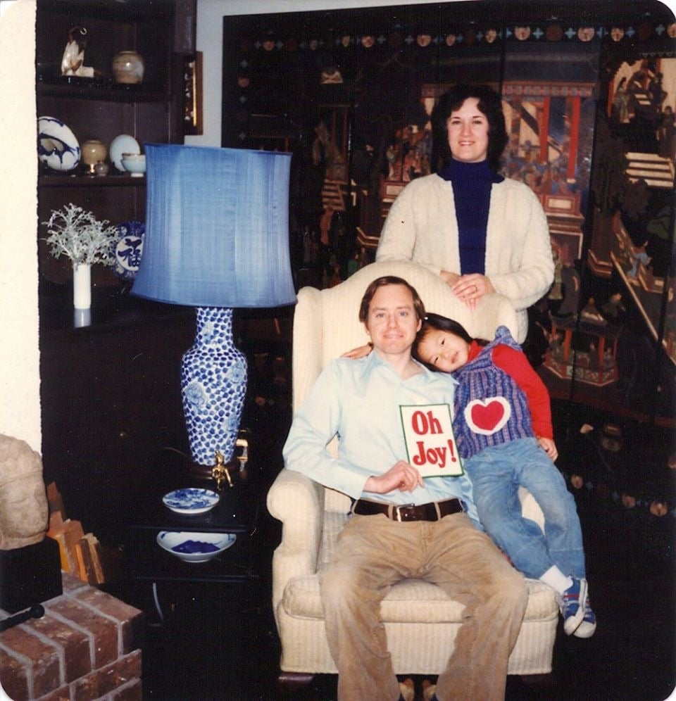 Me with my mom and dad. I would still wear everything I'm wearing in this photo.