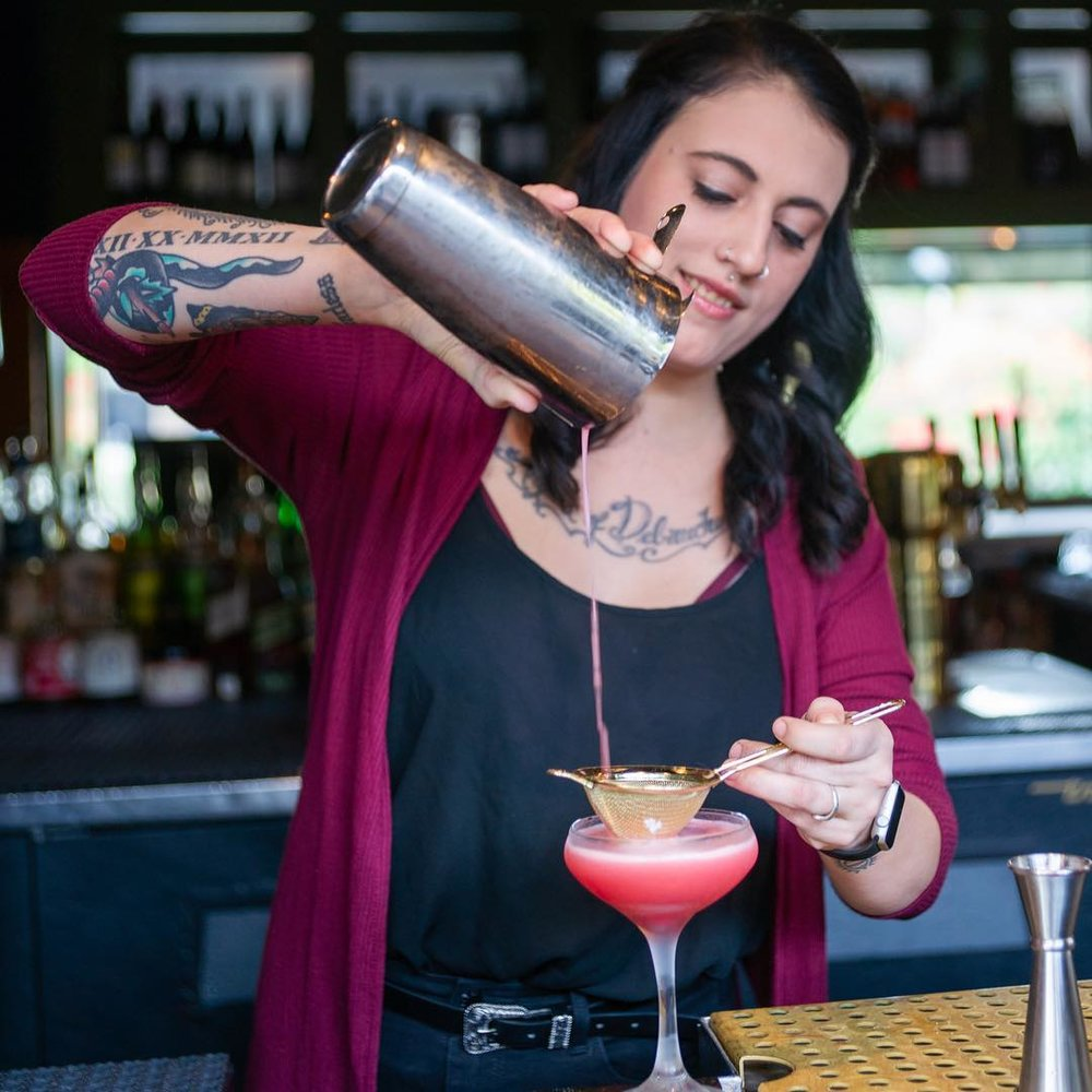Samantha from the Windsor pouring a cocktail (not the No. 88 but still looks delish.