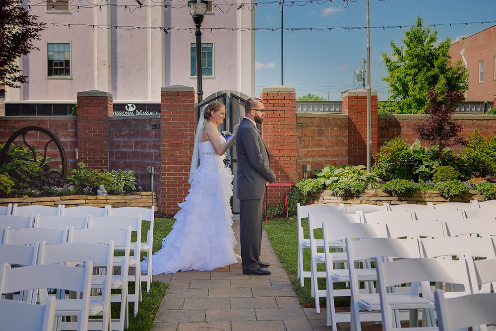 Bride and groom meet each other briefly in the courtyard of the Savoy Ballroom, Springfield, Missouri