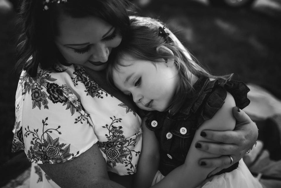black and white mother and daughter family pose workshop brittany gunter