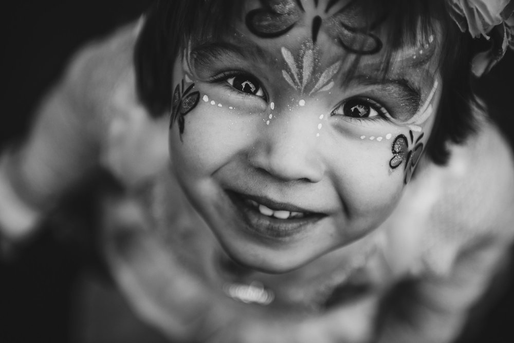 natalie marotta black and white child face paint emotive family photography posing