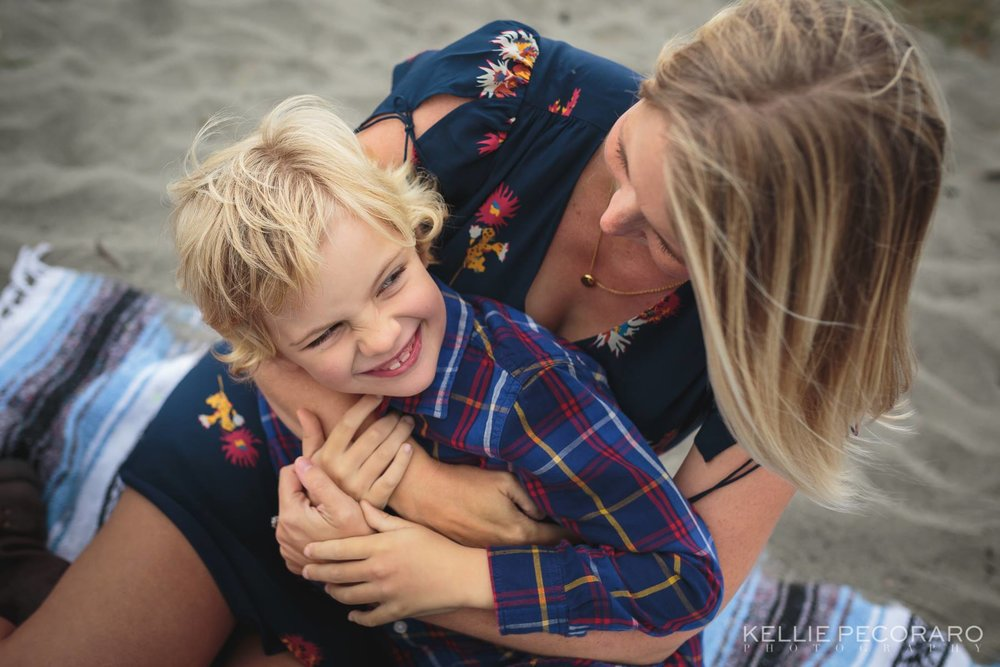 kellie pecoraro beautiful connected emotive family photography posing mother son beach