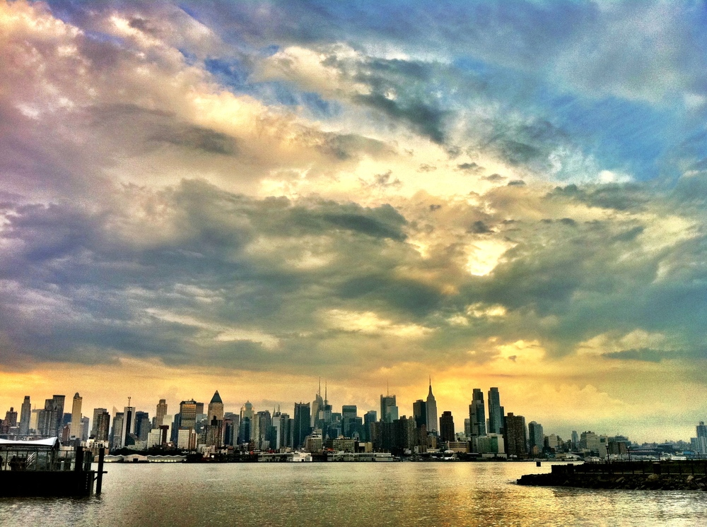The New York City skyline after a stormy afternoon from Port Imperial, NY Waterway in Weehawken, New Jersey. Photo by Anthony Quintano.