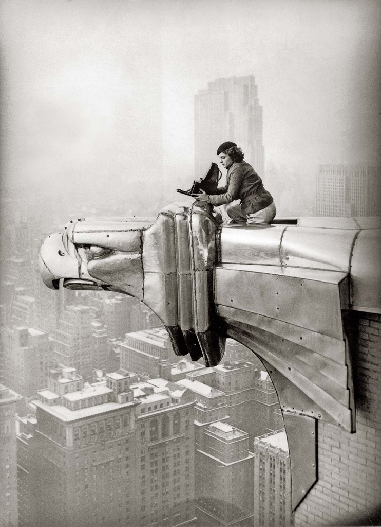 This photo of Life Magazine's photojournalist Margaret Bourke-White atop a steel gargoyle protruding from the 61st story of the Chrysler Building was taken by her dark room assistant Oscar Graubner in 1934.