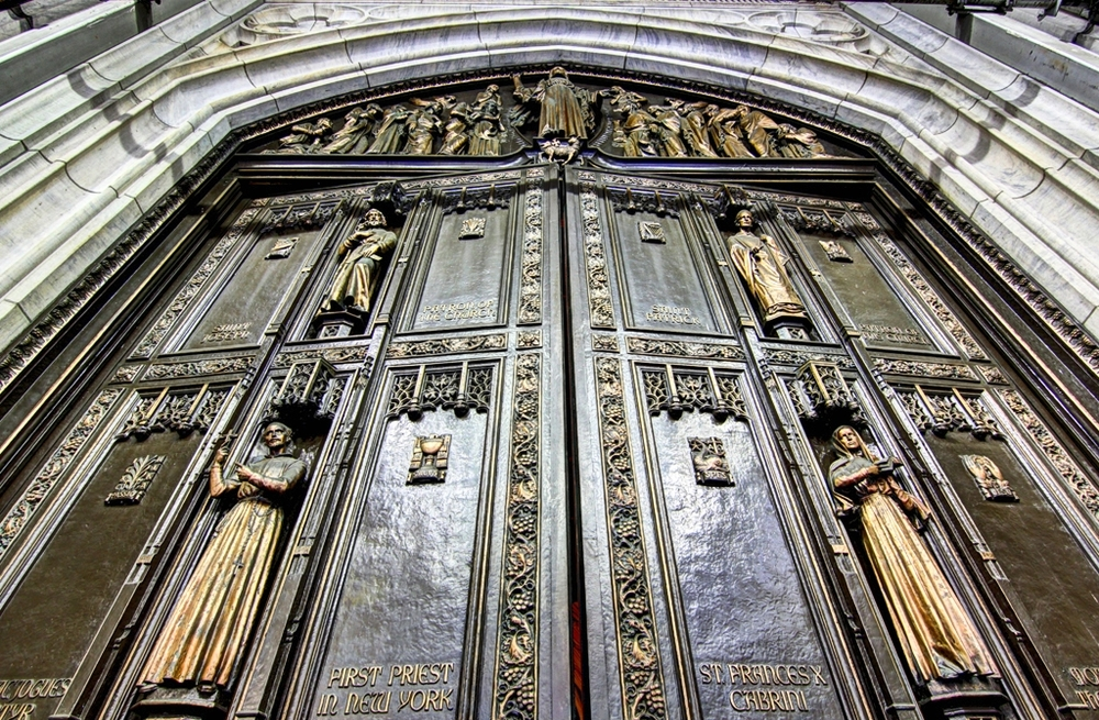 St. Patrick's main doors are made of bronze, and each weigh 9,200 pounds ( 4,173 kilograms )
