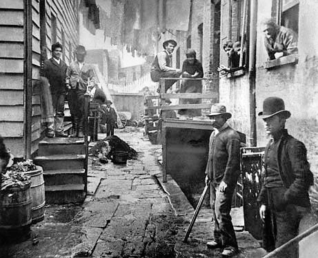 Around 1888, men gather in an alley called Bandits Roost in Manhattans Five Points neighborhood, the setting of the movie Gangs of New York. This and other Jacob Riis photographs inspired the city to raze the notorious Mulberry Bend block—and Bandits Roost with it. Photo: Jacob Riis