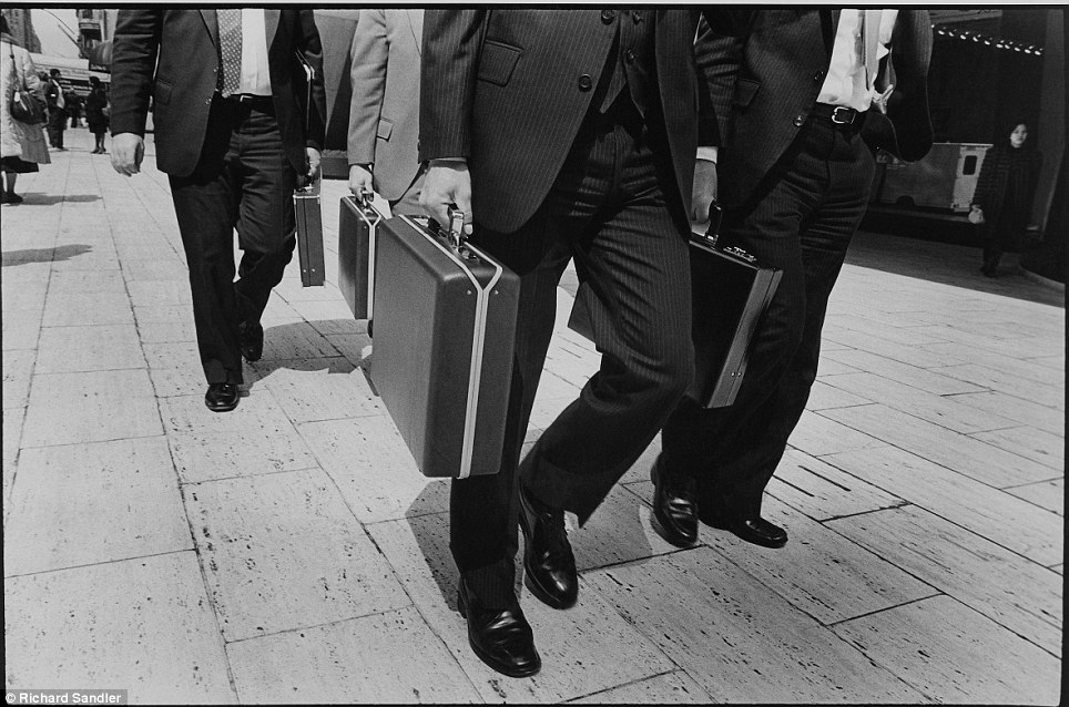 The rate race: 'Men and Briefcases' shows rush hour at 57th Street as suited men head to work in 1980. Photo: Richard Sandler