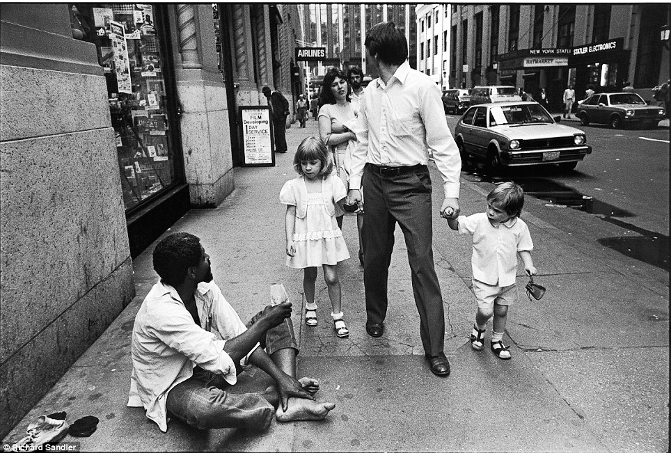 New York state of mind: Two children stare curiously at a homeless man as they walk with their parents on 32nd Street in 1981. (Photo: Richard Sandler)
