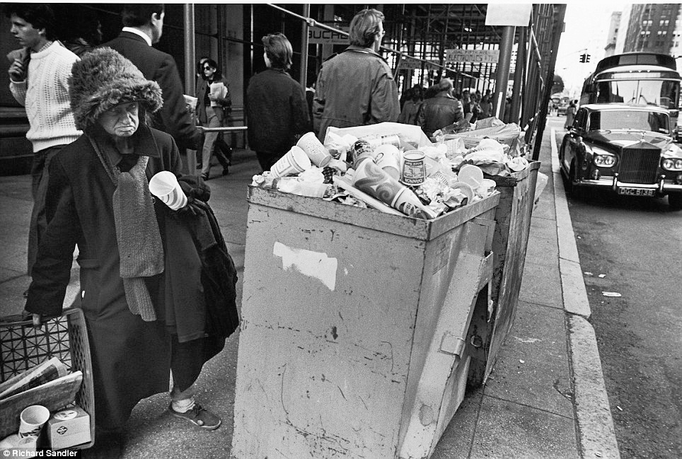 Life on the streets: A homeless woman stands bear overflowing trash on Fifth Ave in 1980. (Photo: Richard Sandler)