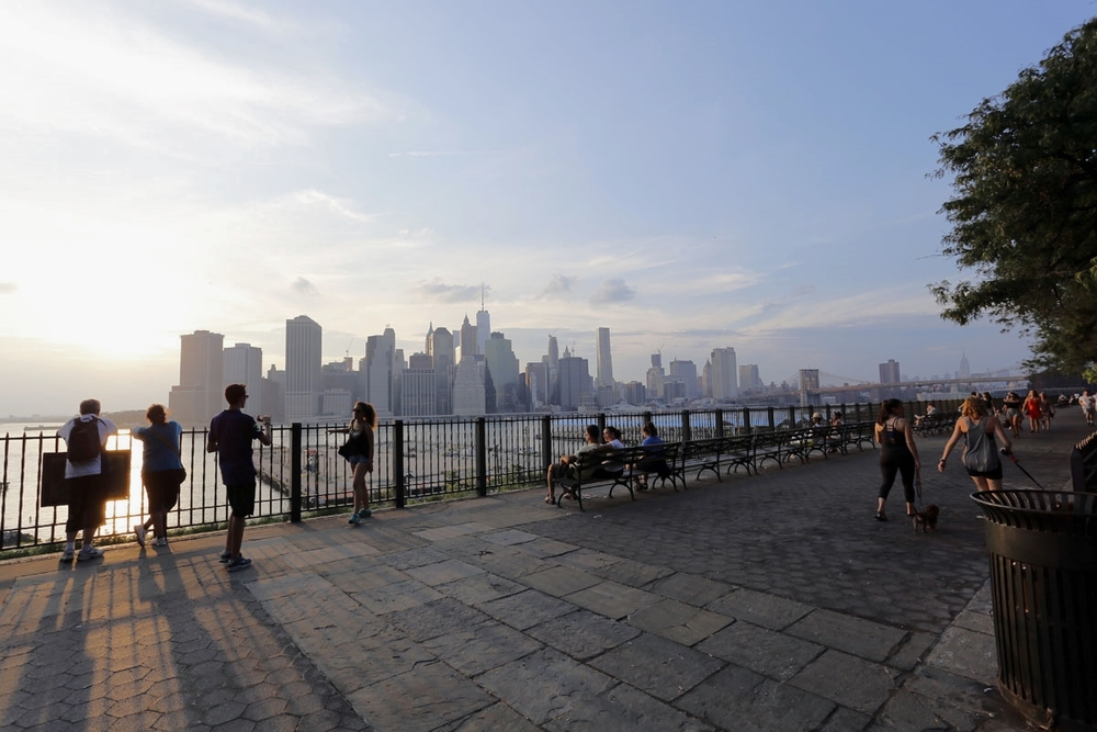 The sunset from the Brooklyn Bridge Promenade is something you must not not miss