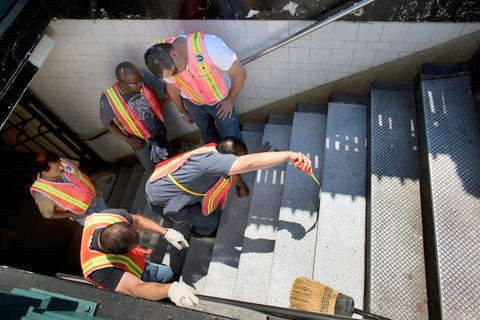 Victor J. Blue for The New York Times  A repair effort on Thursday to fix a notorious step at the 36th Street subway station in Sunset Park, Brooklyn. The step, which had been taller than the others, caused many subway riders to trip as they rose from the station.