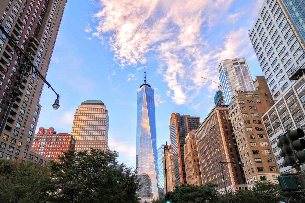 Freedom Tower surrounded by the vivid colors of a beautiful sunset
