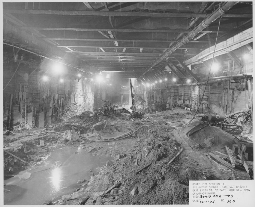 Photograph documents  (1975) construction on the Second Avenue Subway. View of tunnel looking South from beam 256, 12/1/1975 ( Courtesy of New York Transit Museum ).   Click here to see more photograph documents from 1975 .