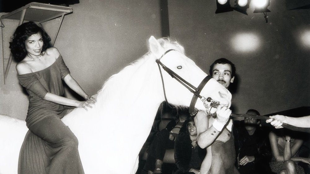 Bianca Jagger ride a white horse into the club for her 30th birthday party. Credit: Hasse Perrson