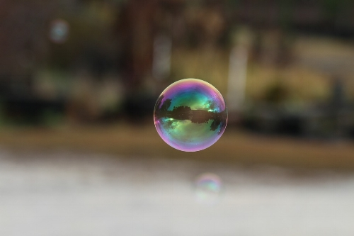 The colors you see are wavelengths of light reflecting off the soap bubble.